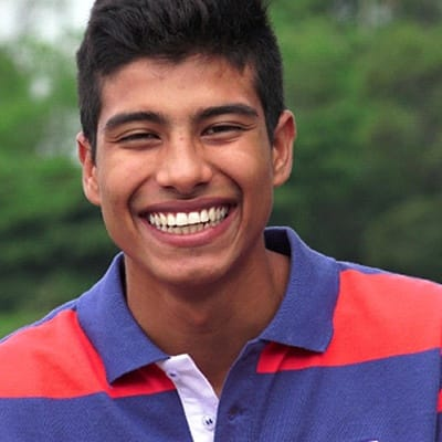 a male teenager smiling