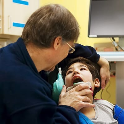 Dentist examining child's smile