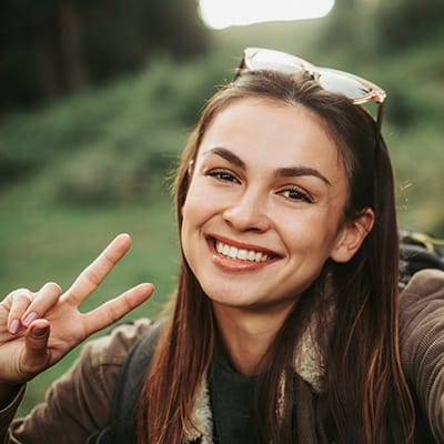 Woman with healthy smile outdoors