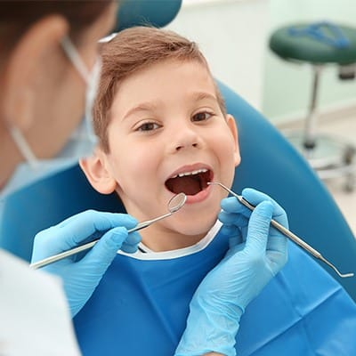 Little boy in dental chair during exam