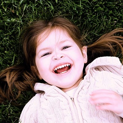 Laughing little girl outside